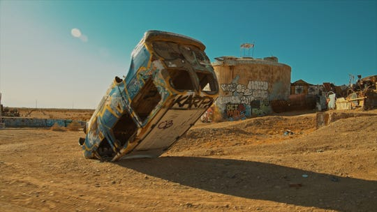 """A film still from Rancho Mirage director Leo Zahn's documentary """"Iconicity,"""" about art in the California desert, featuring the community of Slab City in Niland, Calif."""