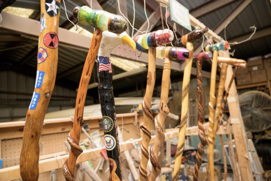 Finished canes are hung to dry at Oscar Morris' woodshop in Eustis.