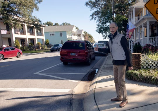 Rand Hicks, president of Council of Neighborhood Association Presidents of Pensacola, takes a tour of downtown Pensacola homes on Wednesday. Hicks is working on a plan to form a neighborhood association for the downtown area.