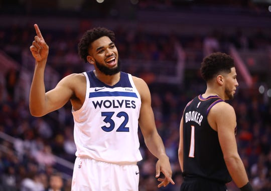 How would Minnesota Timberwolves center Karl-Anthony Towns (32) do as a member of the Phoenix Suns?