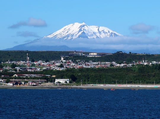 View from the Holland America Zaandam of the Calbuco volcano, which last erupted in 2015, as it peeks over the clouds in the Chilean port of Puerto Montt.
