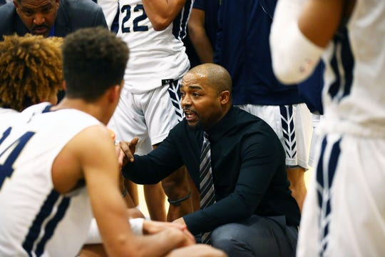Desert Vista High head coach Mike Smith huddles with his players during a timeout against Highland High during a game on Jan. 7, 2020 in Phoenix, Ariz.