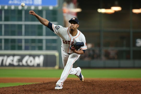 Houston Astros relief pitcher Hector Rondon (30) pitches against the Washington Nationals during the eighth inning of game two of the 2019 World Series at Minute Maid Park.