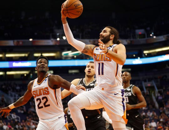 Phoenix Suns guard Ricky Rubio (11) lays the ball in against the Sacramento Kings during the first quarter at Talking Stick Resort Arena January 7, 2020.