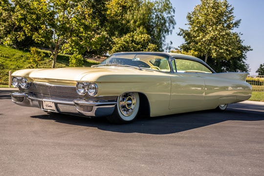The last car to be auctioned off from Barker's collection is a customtwo-door 1960 Cadillac Coupe de Ville Hardtop.