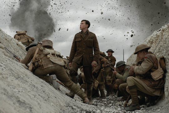 """George MacKay (center) as Schofield in """"1917."""""""
