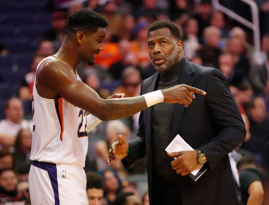 Phoenix Suns center Deandre Ayton (22) talks with assistant coach Mark Bryant during the fourth quarter against the Sacramento Kings at Talking Stick Resort Arena January 7, 2020.