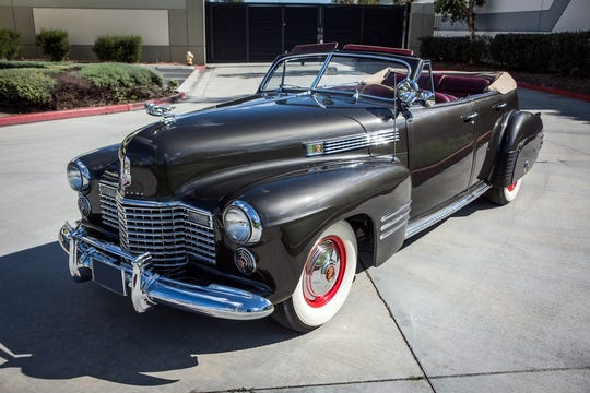 The first car to be sold from Barker's collection Thursday is a 1941 Cadillac Series 62 deluxe convertible sedan.