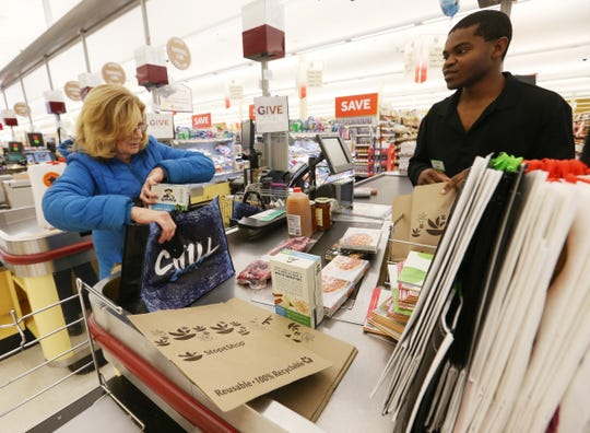 Pat Cohen of Wappingers Falls checks out with Dylan Facey at the Stop and Shop in the Town of Poughkeepsie on January 7, 2020.