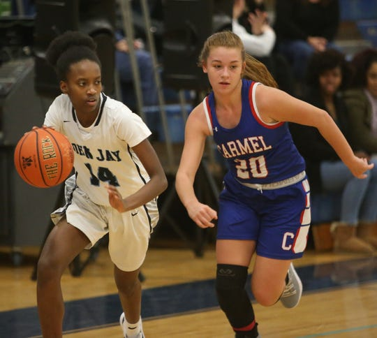 John Jay's Stephanie Jean-Baptiste drives down court ahead of Carmel's Caitlyn Webber during Tuesday's game on January 7, 2019.