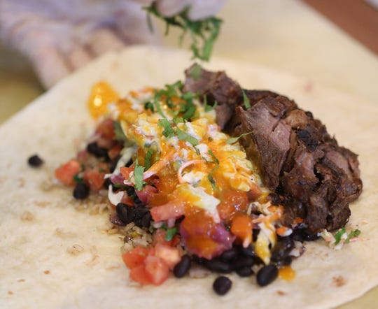 Mexicali Blue chef Will Van Pelt prepares a short rib burrito at the restaurant in Wappingers Falls on January 8, 2020.