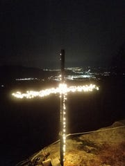 James D. Brooks installed a temporary cross on Honness Mountain to take the place of the cross that was vandalized.