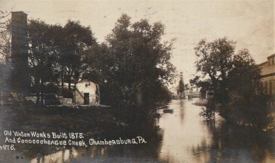 This picture was taken during the early 1900s and shows the Water Works Building that was built in 1875 along the Conococheague Creek in Chambersburg.
