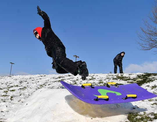 David Bluett, 13, flies off his sled while going over a ramp  while taking advantage of a snow day at Springettsbury Township Park, Wednesday, January 8, 2020.