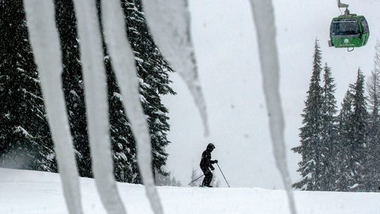 A skier takes advantage of the snowy conditions at Silver Mountain in Kellogg, Idaho. The Shoshone County Sheriff's Office said Tuesday, Jan. 7, 2020, it received reports of up to three separate avalanches on the mountain and that emergency responders were coordinating rescue efforts.