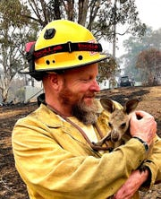 Fire Captain Dave Soldavini, of the Lake Tahoe Basin Management Unit, holds a baby kangaroo, also called a Joey, that was rescued from the devastating wildfires in Australia.