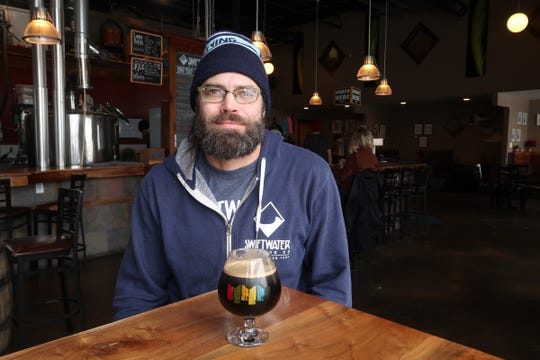 Owner/brewer Andy Cook inside his tasting room at Swiftwater Brewing in the South Wedge.