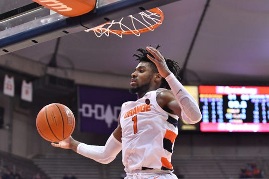 Syracuse Orange forward Quincy Guerrier (1) dunks the ball in the second half against the Virginia Tech Hokies at the Carrier Dome.