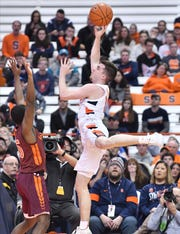 Syracuse Orange guard Joseph Girard III (11) shoots the ball as Virginia Tech Hokies guard Jalen Cone (15) defends in the first half at the Carrier Dome.