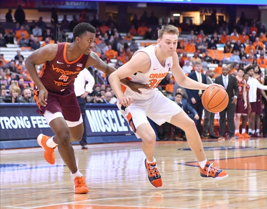 Syracuse Orange guard Buddy Boeheim (35) drives the ball against Virginia Tech Hokies guard Nahiem Alleyne (4) in the second half at the Carrier Dome.