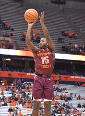 Virginia Tech Hokies guard Jalen Cone (15) takes a jump shot in the first half against the Syracuse Orange at the Carrier Dome.