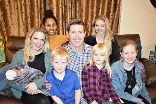 Joseph LeTourneau, who is in the congressional primary for the North State's District 1, sits with his wife Destiny, newborn Halle, daughter Ayni in the top left, Mercy in the top right, and in the front, William, Aliyah and Galilee. Missing is eldest daughter, Anna, who is away finishing college.