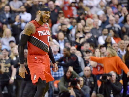 Portland Trail Blazers forward Carmelo Anthony (00) reacts after sinking a go-ahead basket against the Toronto Raptors during the second half of an NBA basketball game Tuesday, Jan. 7, 2020, in Toronto.