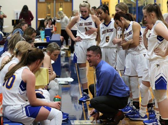 Veribest High School head coach Chris Schlicke goes over strategy with the Lady Falcons during a home game against Bronte on Tuesday, Jan. 7, 2020.