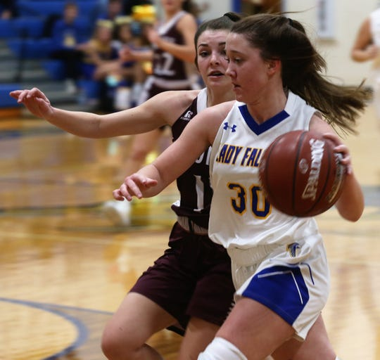 Veribest High School's Callie Briley drives past a Bronte player during a game at Veribest on Tuesday, Jan. 7, 2020.