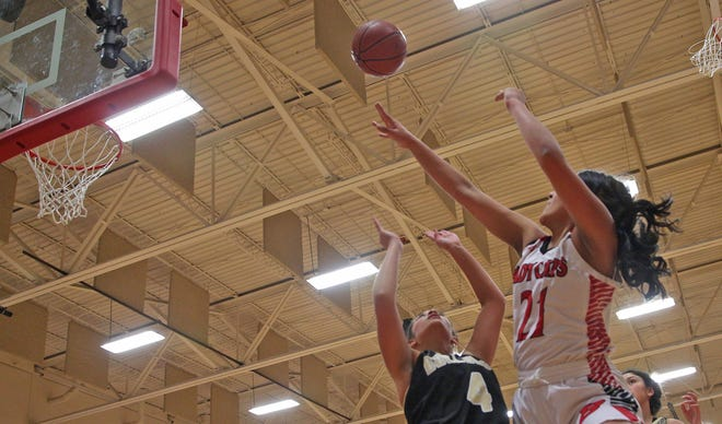 Chelsea Martinez, right, launches a shot for Ballinger during a game against Brady on Tuesday, Jan. 7, 2020.