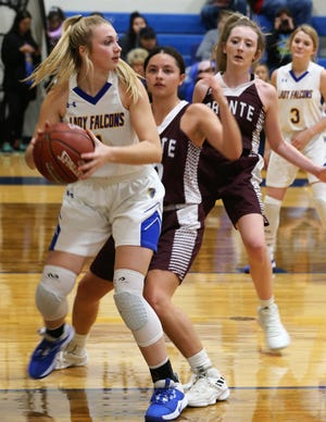 Veribest High School's Emily Ward looks to pass the ball to a teammate during a home game against the defense of Bronte's E'lexia Davis (middle) and Katelyn Powell (right) on Tuesday, Jan. 7, 2020.