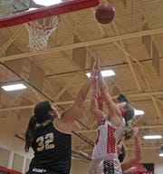 Dalli Miller, left, tries to block a shot for Brady during a game against Ballinger on Tuesday, Jan. 7, 2020.