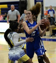Stephen Decatur forward Jessica Janney fights for possession against Wi-Hi on Tuesday, Jan. 7, 2020.