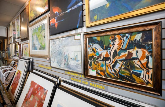 Jerry Sanders' mother and her twin sister painted many of the pieces of art that are for sale at the National Art Shop. The store, located at 509 S. National Ave., is celebrating its 50th anniversary this year.