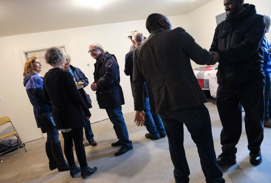 People gather before a dedication ceremony for a new Central Minnesota Habitat for Humanity home Wednesday, Jan. 8, 2020, in St. Cloud.