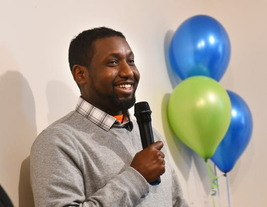Ahmed Abdi thanks volunteers for their work on the new home he will share with his wife and five children during a Central Minnesota Habitat for Humanity dedication Wednesday, Jan. 8, 2020, in St. Cloud.