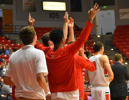 The Dixie State bench reacts to a big play against Colorado School of Mines.