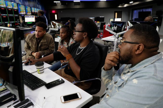 The Black News Channel digital team works together in the newsroom Tuesday, Jan. 7, 2020.