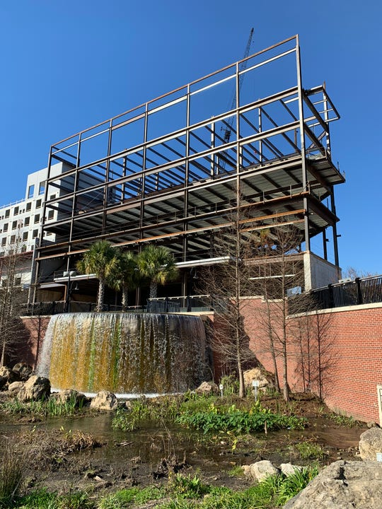 The view of the waterfall at Cascades Park now includes scaffolding that will become part of the Cascades Project.