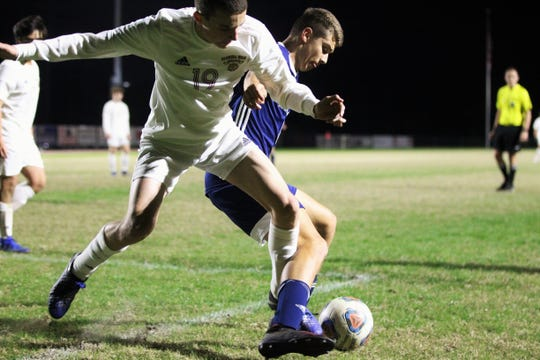 Maclay senior defender Alex Guzman battles Florida High's Payton Pafford for possession as Maclay beat Florida High 3-1 on Jan. 7, 2019.