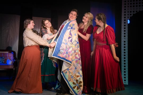"""Jo March (Courtney Fitzgerald) and her sisters welcome Laurie Laurence (Conner Fabrega), their neighbor, as they become """"Five Forever"""" in Monticello Opera House's production of """"Little Women."""""""