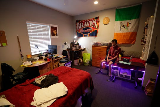 Kyle Falvey and his roommate chose to go with a non-traditional route for the layout of the second-floor bedroom they share at the Bill and Nancy Malthouse scholarship house.