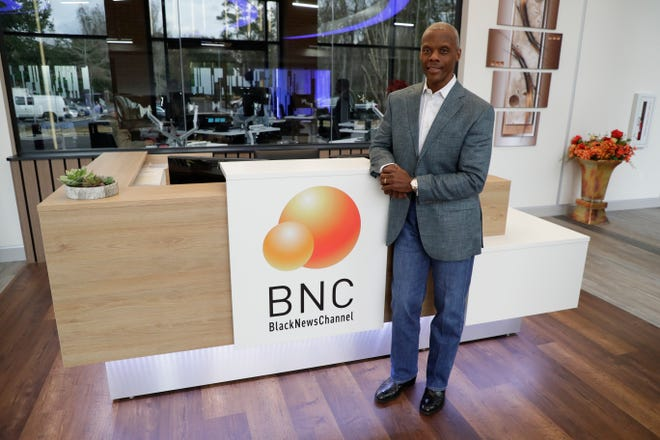 Black News Channel Co-founder J.C. Watts stands in the lobby of the news network Tuesday, Jan. 8, 2020.
