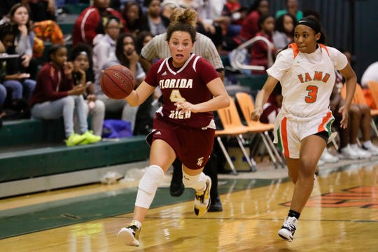 Florida High's Jordan Rosier (4) runs by Ashley Reddick of FAMU DRS during a Seminoles win on Tuesday, Jan. 7, 2020.