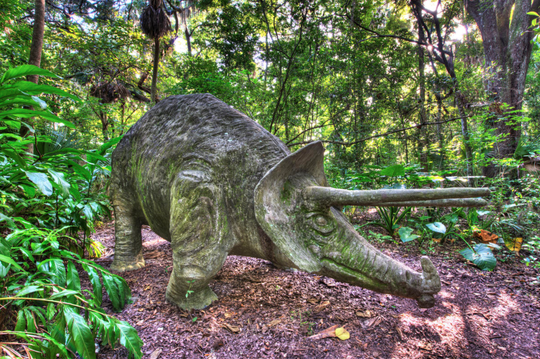 Stone statues of dinosaurs can be found throughout the Dunlawton Sugar Mill Gardens, remnants of Bongoland, an amusement park created there in the 1940s.