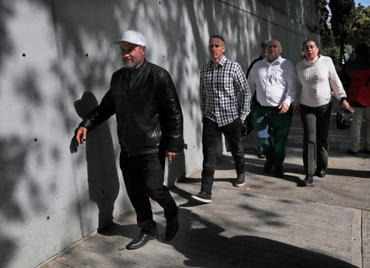 Adrian LeBaron, left, who lost relatives and friends in a Nov. 4, 2019, ambush in northern Mexico, leaves the office of the Special Prosecutor for Organized Crime Investigation, where they met with authorities in Mexico City on Tuesday, Jan. 7, 2020. Prosecutors said Tuesday more than 40 suspects have  been identified in connection with the slaughter of the nine U.S. dual-national women and children.