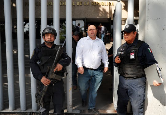 Julian LeBaron, center, who lost relatives and friends in a Nov. 4, 2019, ambush in northern Mexico, leaves the office of the Special Prosecutor for Organized Crime Investigation, where he met with authorities in Mexico City on Tuesday, Jan. 7, 2020. Prosecutors said Tuesday more than 40 suspects have  been identified in connection with the slaughter of the nine U.S. dual-national women and children.