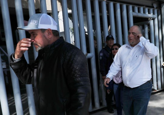 Adrian, left, and Julian LeBaron, who lost relatives and friends in a Nov. 4, 2019, ambush in northern Mexico, leave the office of the Special Prosecutor for Organized Crime Investigation, where they met with authorities in Mexico City on Tuesday, Jan. 7, 2020. Prosecutors said Tuesday more than 40 suspects have  been identified in connection with the slaughter of the nine U.S. dual-national women and children.