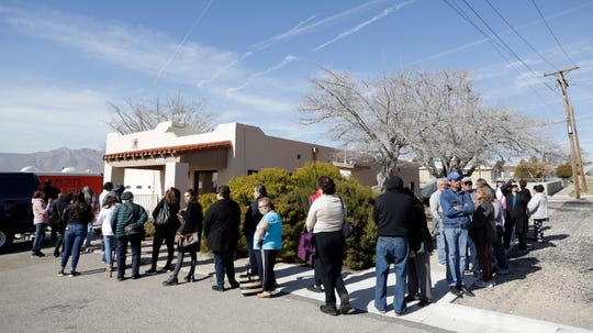 About 70 El Pasoans line up for free influenza vaccines outside the El Paso Fire Department Safety, Health and Outreach Center at 5415 Trowbridge Drive in Central El Paso.