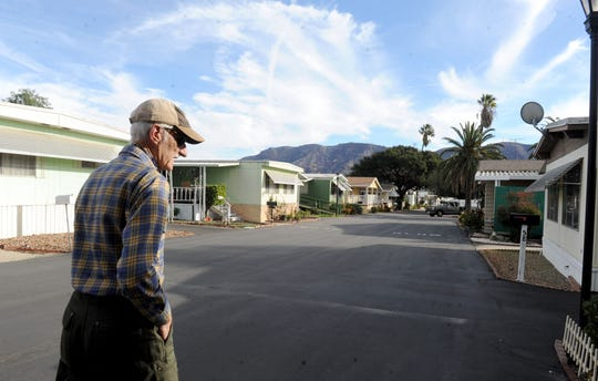Barry Cooper walks near his home at the Oaks Estate mobile home park in Santa Paula. Residents are fighting a rent increase for the mobile home park, which was approved by the Mobile Home Rent Review Commission. The rent increase, which residents say will be about double their current rent. Residents recently submitted an appeal to the commission.